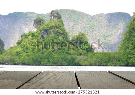 Defocus and blur image of terrace wood and Beautiful mountain midst of andaman sea for background usage