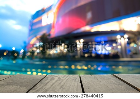 Defocus and blur image of terrace wood and swimming pool in modern hotel for background usage - stock photo