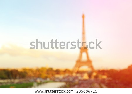 defocus bokeh blurred of silhouette eiffel tower in Paris with sunset, great for your design and background - stock photo