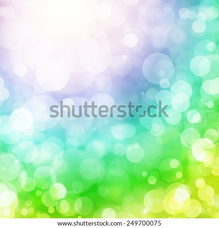 Defocused abstract background. Circles on soft beautiful green, blue, yellow, violet tone color background.