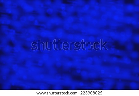 Defocused abstract blue lights background - stock photo