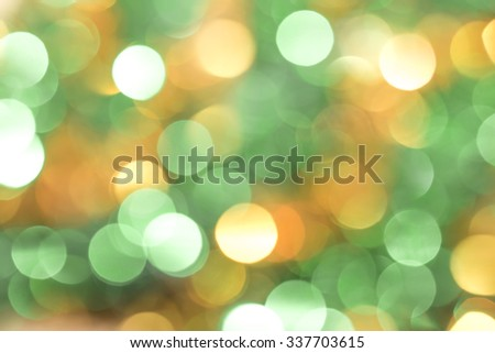 Defocused abstract green and yellow christmas background - stock photo