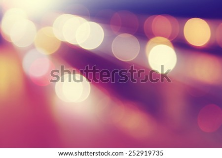 Defocused abstract lights background in motion blur. - stock photo