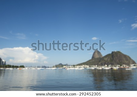 Defocused abstract view of Sugarloaf Mountain and Rio de Janeiro Brazil skyline reflecting on Botafogo Bay - stock photo