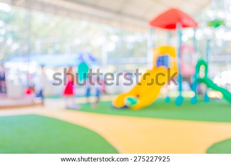 Defocused and blur image of children's playground at public park for background usage. - stock photo