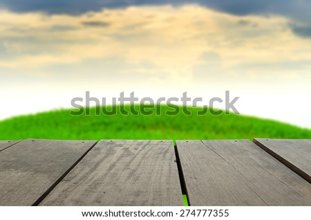 Defocused and blur image of terrace wood and beautiful mountain for background usage - stock photo