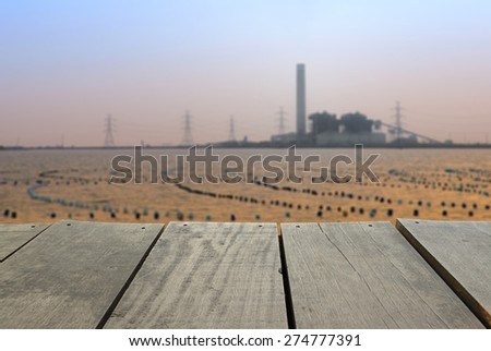 Defocused and blur image of terrace wood and Coal-Fired Power Plant industrial view for background usage - stock photo