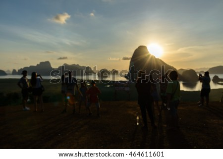 Defocused and blurred image for background of A crowd shooting photo on SAMET NANG SHE new landmark in Phang nga ,Thailand.