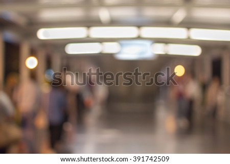 Defocused and blurred image for background of people rush hour on walkway - stock photo