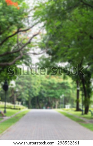 Defocused and blurred image for background of walkway in public park - stock photo