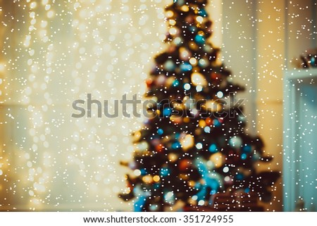 Defocused background Living room with christmas tree, and snow - stock photo