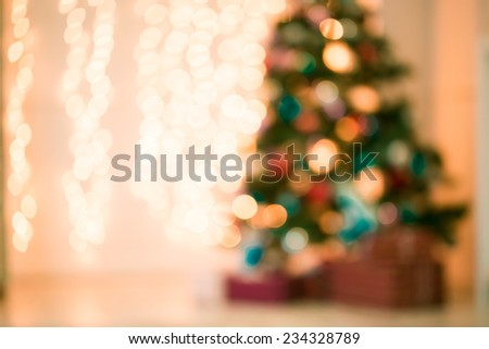 Defocused background Living room with christmas tree. Pink toned - stock photo