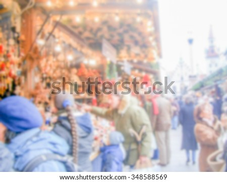 Defocused background of a Christmas Market in Munich, Germany. Intentionally blurred post production for bokeh effect - stock photo
