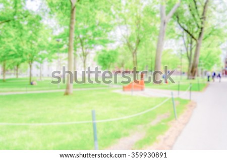 Defocused background of a typical university campus. Intentionally blurred post production for bokeh effect - stock photo
