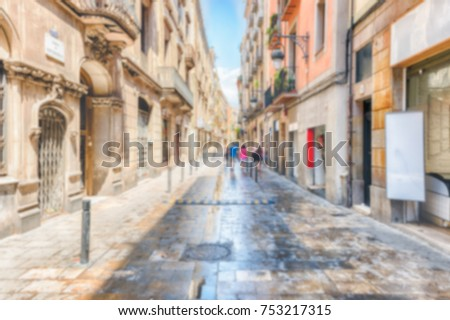 Defocused background of Carrer de Sant Pere Alt in La Ribera district of Barcelona, Catalonia, Spain. Intentionally blurred post production for bokeh effect