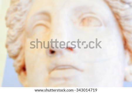 Defocused background of classical sculpture. Intentionally blurred post production for bokeh effect - stock photo