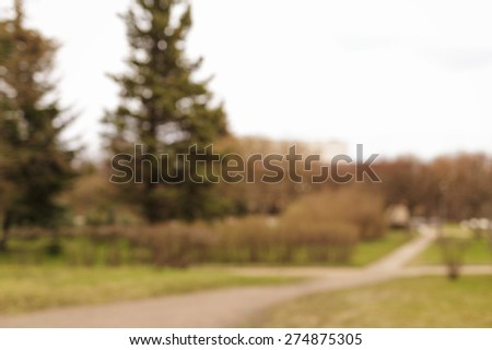 defocused background of park in town - stock photo