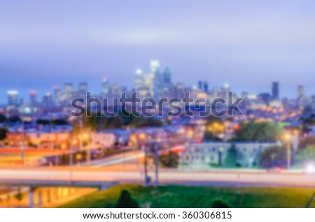 Defocused background of Philadelphia Skyline at Night. Intentionally blurred post production for bokeh effect - stock photo