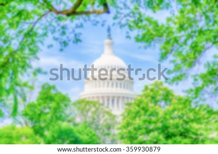 Defocused background of the United States Capitol building, Washington DC, USA. Intentionally blurred post production for bokeh effect - stock photo
