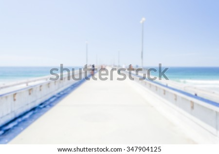 Defocused background of Venice Beach Pier in California, USA. Intentionally blurred post production for bokeh effect - stock photo