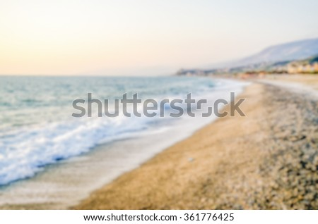 Defocused background with a mediterranean beach in Italy. Intentionally blurred post production for bokeh effect - stock photo