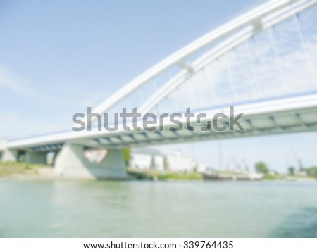 Defocused background with detail of Apollo Bridge in Bratislava, Slovakia. Intentionally blurred post production for bokeh effect - stock photo