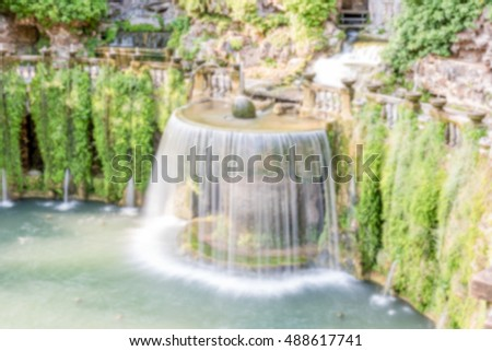 Defocused background with Oval Fountain in Villa d'Este, Tivoli, Italy. Intentionally blurred post production for bokeh effect