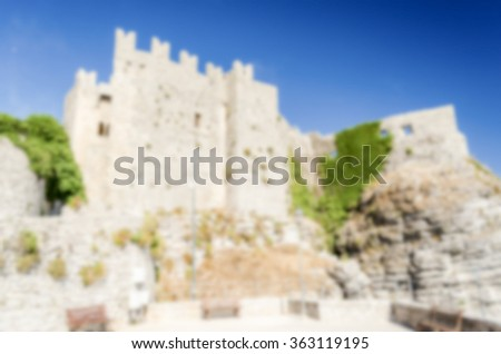 Defocused background with view over Venus Castle in Erice, Sicily. Intentionally blurred post production for bokeh effect - stock photo