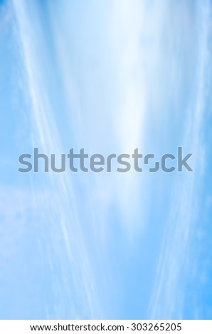 defocused blue flowing water background texture
