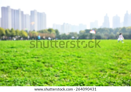 Defocused blur abstract background of central park - stock photo