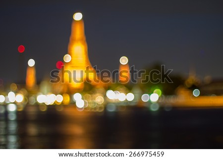 Defocused blur bokeh background. Wat Arun Temple in bangkok thailand with Chaopraya river. - stock photo