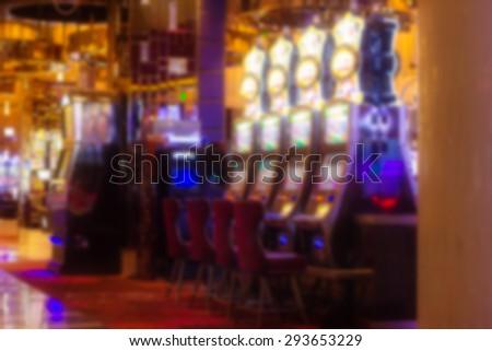 Defocused blur of colorful lit Las Vegas slot machines - stock photo