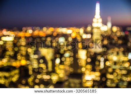Defocused blur of New York City buildings lights at night - stock photo