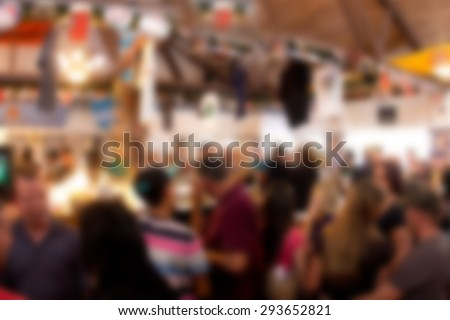 Defocused blur scene of crowded bar at beer garden - stock photo