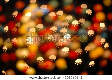 defocused bokeh lights. filtered could and rain bokeh blurred background.