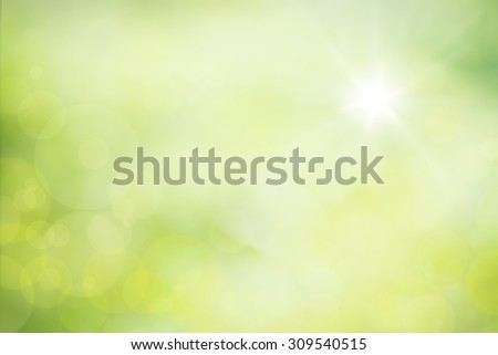 Defocused bokeh lights on green yellow blurred background  - stock photo