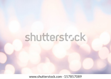 Defocused Bokeh twinkling lights background. Colorful   Abstract twinkled  bright golden festive background, soft pink and red colors.