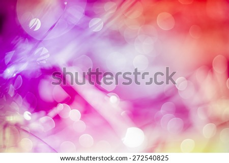 Defocused Bokeh, twinkling lights vivid color blurred bokeh abstract light spring forest background. Natural bokeh from leaf tree. Blur picture style. - stock photo