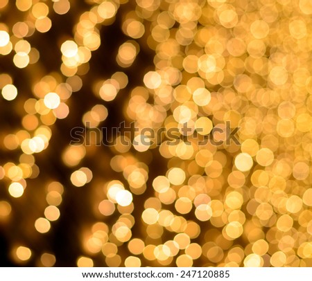 Defocused Christmas bright golden lights ideal for backgrounds