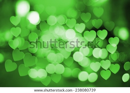 defocused christmas lights on soft green colors tone - stock photo