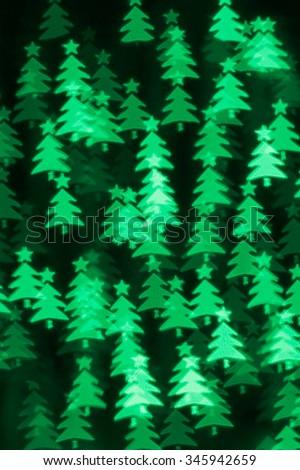 Defocused Christmas trees bokeh defocused background - stock photo