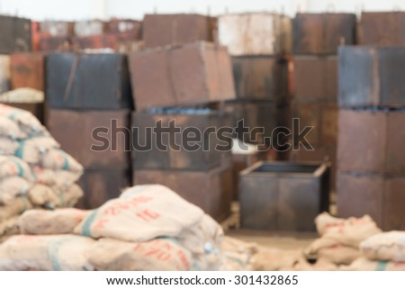 Defocused container and packing bag in warehouse for industrial background - stock photo