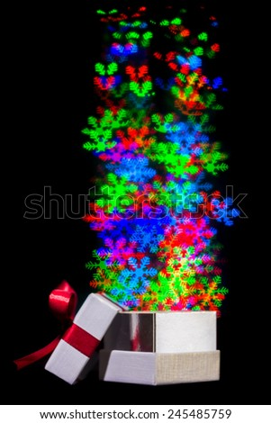 Defocused flower lights are moving out of open gift box - stock photo