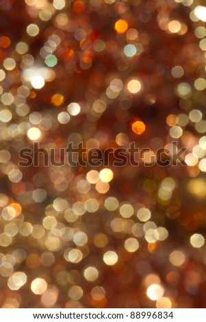 defocused gold bokeh background with yellow, orange and white lights - stock photo