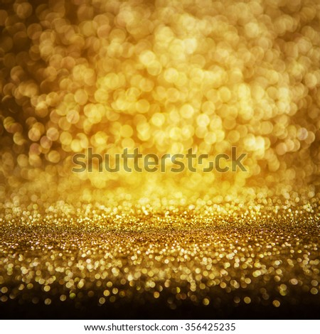 Defocused golden abstract holidays lights on background - stock photo