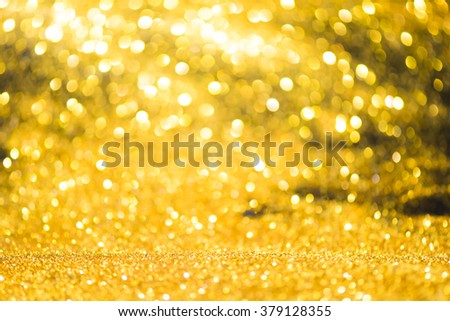Defocused golden abstract holidays lights on background