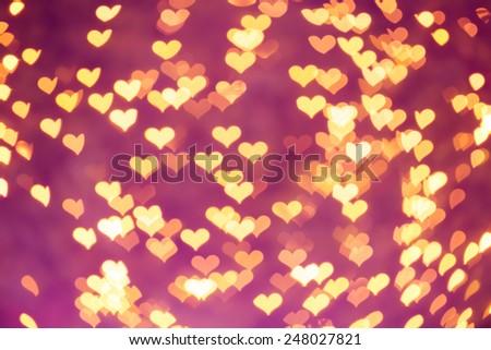 Defocused heart bokeh on christmas light background - stock photo