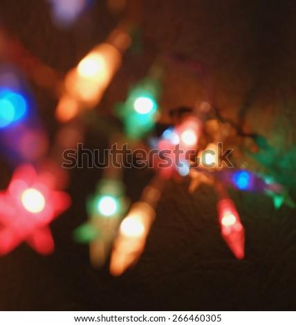Defocused holiday lights - stock photo