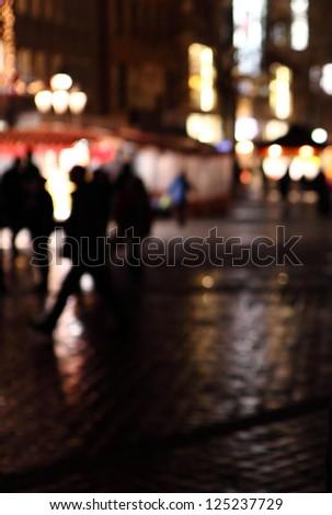 defocused image of street: abstract urban scene at night - stock photo