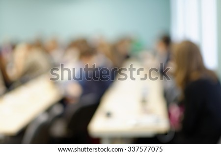 Defocused image of students in a classroom - stock photo